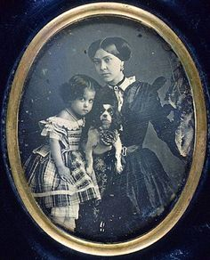 """Portrait of a woman and girl with dog, ca. 1855. daguerreotype 1/4 plate (oval) Gift of Eastman Kodak Company EXHIBITION HISTORY: """"French Daguerreotypy"""", US, NY, Rochester, GEH - Brackett Clark Gallery, February - June, 1977.// via @KaufmannsPuppy"""