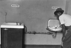 "Elliott Erwitt, North Carolina, 1950.  Separate water fountains for ""White"" and ""Colored."""