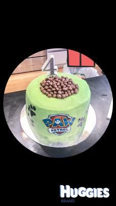 Paw Patrol doggy bowl paw print surprise inside cake.     Vanilla cake with chocolate cake pop mix for the paw print inside!