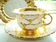 Meissen Porcelain Cup Saucer in gold and white