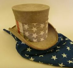 1892 Campaign Hat & Scarf   These elements of a 19th century Uncle Sam costume have only a tangential Newport connection. But, in this patriotic town, with its deep roots in the American story, we know we will find an interpretive use for them.    They were used as part of the 1892 presidential campaign in Illinois. This election was unsual in that Grover Cleveland, former president, challenged Benjamin Harrision, incumbent.  The objects were donated to the Society by John B. Hattendorf.