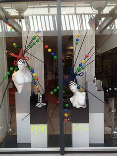 Creativ window display for a hairstyling salon. Styled by Rich Art Design.