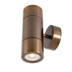 Underscored by a minimal cylindrical tube shape and designed to mount vertically, this brass wall light brightens up hallways, walkways and entryways. Outdoor Ceiling Lights, Outdoor Pendant Lighting, Industrial Wall Lights, Sign Lighting, Outdoor Walls, Accent Lighting, Light Picture Wall, Bathroom Wall Sconces, Light Bulb Bases