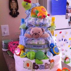 Turtle diaper cake I made for my girl friend. Caden's colors are blue and green so I used Target brand diapers. His big brothers theme was elephants so when I found this blanket it was perfect!