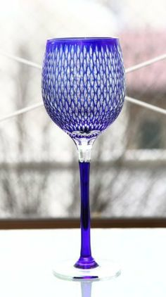 Edo Kiriko Wine Glass: Blue by Hanashyo. $1999.00. The origin of Edo Kiriko dates back to 1834 in the Edo period when Kagaya Kyubei, a glass artisan working in Odenmacho, Edo, used emery powder to produce glassware engraved with patterns. In the 150 years, since Edo Kiriko has further evolved and has captivated the hearts of many people. Commodore Perry who sailed his warships into Edo Bay in 1853, was deeply impressed by the artistry and elegance of Edo Kiriko. Hanashyo's art...