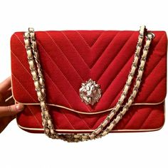 I like - goes well with my LEO side.... Chanel collector's lion bag CHANEL Red