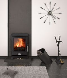 The cleverly designed air control on the Style allows you to switch between solid fuel and wood as well as controlling the air intake. The end result is exquisite controllability and a magnificent flame picture. Living Room Plan, Living Room Designs, Flame Picture, Black Interiors, Multi Fuel Stove, Fire Places, Garage House, School Design, Wood Burning