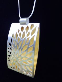 Hand pierced sterling necklace with gold leaf. One-of-a-kind