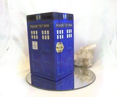 Hey Whovians! Do you have some treasures to hide away? Or are you ready to give your companion a gift of jewelry? Then this box is for you!  YOU CHOOSE either: A. The 7 x 4 x 3 1/2 inches tall wooden TARDIS box B. The 5.5 long, 2 3/4 wide and 2.5 tall wooden Tardis box with RING INSERT (in blue satin) shown in the LAST 2 PICTURES  This wooden box with lid and brass hinges has been hand painted on three sides to look like the famous TARDIS of Dr. WHO. The TARDIS is quite detailed and...