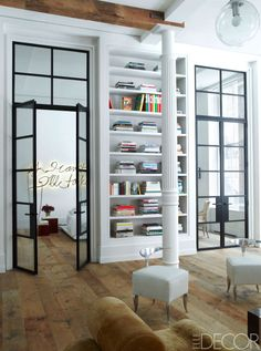 The Philippe Starck chairs in the library were prototypes for the Royalton Hotel, and the custom-made painted steel doors have handles by H. Theophile.