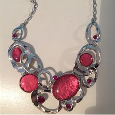 """HP a Pretty in Pink Necklace and Earrings Beautiful costume silver necklace and earrings set with gorgeous pink stones. Necklace is adjustable to 20"""". Earrings are approximately .75"""". Boutique Jewelry Necklaces"""