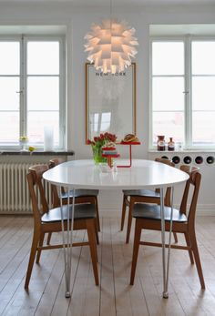 Scandinavian home with white dining table and wood chairs