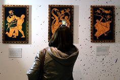 """To celebrate Vladimir Putin's 62nd birthday on Tuesday, supporters in Moscow hosted a one-day art exhibition, """"The 12 Labors of Vladimir Putin,"""" on Monday, of paintings depicting him as the mythological hero Hercules recast in modern-day current affairs."""