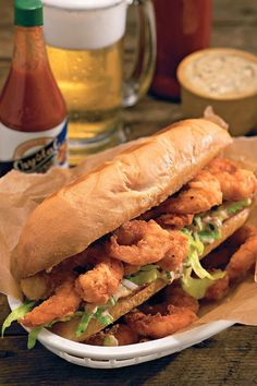 Shrimp Po'boys - 100 Ways to Cook Southern - Southernliving. Recipe: Shrimp Po'boys Try this authentic shrimp po'boy recipe to get a taste of New Orleans' famous cajun cuisine. Southern Cooking Recipes, Cajun Recipes, Shrimp Recipes, Southern Food, Creole Recipes, Sandwiches, Table D Hote, New Orleans Recipes, Seafood Dishes