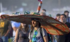 man wearing a huge hat as he listens to a concert at the Woodstock music festival in Kostrzyn, Poland, Saturday, July 31, 2010.