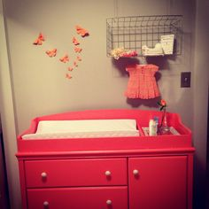Coral and grey nursery.