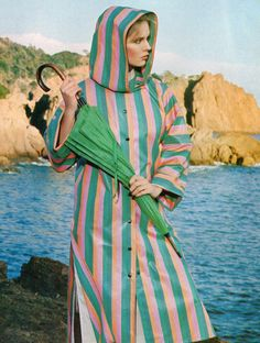 Lanvin- 1977 Green, blue, pink and orange striped hooded raincoat jacket. L'officiel USA Spring 1977