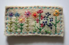 Another hand made brooch by Lizzie, who lives in the Forest of Dean, Gloucestershire, Great Britain.   I think these little hand stitched brooches are just so lovely.  They're like little heirlooms.