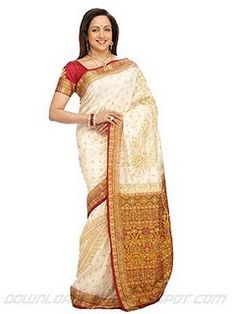 Hema Malini in one of the most often printed color combinations - red, white and gold - stunner!