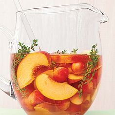 """Cherry-Peach Sangria    """"Who could resist the refreshing combo of fruit, fresh herbs, and wine?"""""""