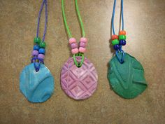 First graders made clay pinch pots and then made these clay charms. They stepped on a small ball of clay to create the texture! The kids LO. Clay Projects, Projects For Kids, Kids Crafts, Auction Projects, Ceramics Projects, Project Ideas, Summer Camp Art, Art Camp, Clay Pinch Pots