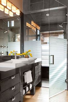 frameless glass shower doors kohler vanity top bathroom sink with single faucet hole black cabinet with drawers and shelves mirror black shower tiles of Cool Frameless Glass Shower Doors to Install in Your Bathroom