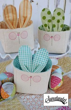 Darling fabric baskets with bunny faces and ears. So cute! And easy to make too.