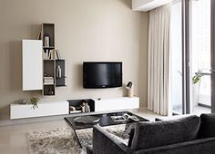 BoConcept Istra sofa, Adria coffee table, and Lugano wall system