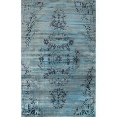 Anchor your living room seating group or define space in the den with this artfully crafted rug, featuring a floral motif for timeless appeal.