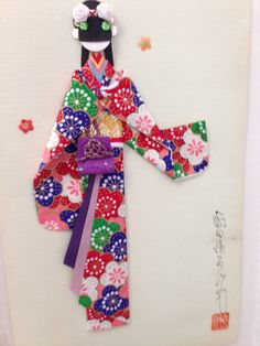Close up of origami doll