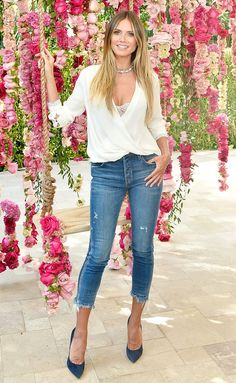 Heidi Klum in a white wrap top and cropped jeans and heels