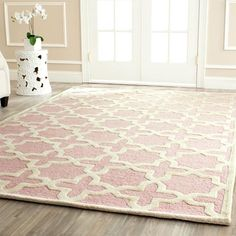 Chloe's room: sooo cute. Soft pink rug   French inspired on concrete floors   For the living room