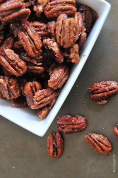 Skillet Cinnamon Pecans make an excellent nibble to have on hand when entertaining or for wrapping up as gifts as a hostess thank you, to toss into a goodie basket for out of town guests, or to give to friends, teachers, and neighbors over the holidays. I warn you though, they are super addictive! //addapinch.com