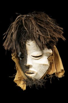 Africa | Mask from the West Pende people of DR Congo | Wood, pigment, raffia