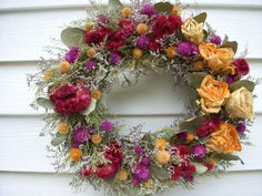 Victorian herb and dried flower wreath in vibrant colors on vine covered with moss and herbs