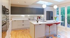 Fitzgeralds Kitchens, Wicklow Belvedere Kitchen - Birch plywood doors and formica laminate bonded to both sides. Cutout handles
