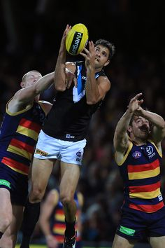 Patrick Ryder of the Power marks over Sam Jacobs of the Crows during the 2015 AFL Round 05 match between the Adelaide Crows and Port Adelaide Power at Adelaide Oval, Adelaide on May (Photo: James Elsby/AFL Media) Hot Rugby Players, Adelaide South Australia, Football Pictures, Men's Football, Crows, Leo, Lancaster, Sports, Ravens