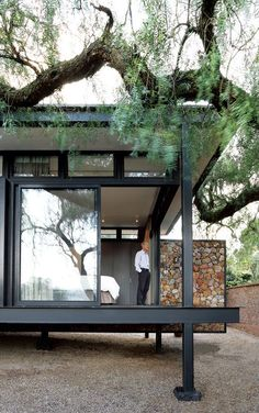 Architect Georg van Gass adds a delicately poised cantilevered exterior wall that appears to slice the deck in half. Photo by: Elsa Young  Courtesy of Elsa Young.