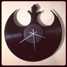 Star Wars clocks made out of records. Rebel Alliance symbol is cool, but I would love a Jedi symbol or Naboo symbol one!