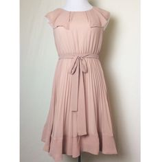 Gorgeous McGinn blush pink dress Feminine and flirty blush dress with beautiful pleating and delicate ruffle around neckline. Excellent condition. McGinn Dresses