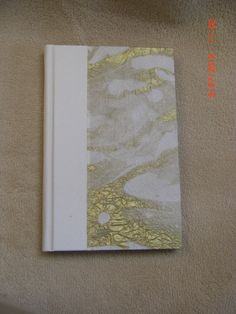 Blank journal made with white leather spine and Thai marbled paper and hand sewn headbands. Made by Roxanne