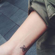 CHIC little Tattoo on wrist - Pinwheel Tattoo Ink
