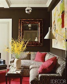 philip gorrivan eclectic living room/den--dark walls, geometric corner sectional, faux tortoise mirror, forsythia branches