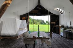 ENVIRONMENTS / uli schallenberg modifies old wooden barn into a luminous living space