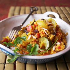 For a healthy slow cooker main dish, throw a mixture of grains, veggies, fruits, and spices into your slow cooker: http://www.bhg.com/recipes/slow-cooker/healthy/easy-healthy-slow-cooker-recipes/?socsrc=bhgpin052314curriedcouscous&page=6