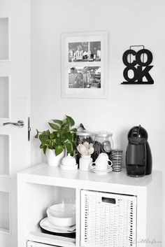 Littlefew Blog // My black and white kitchen: before & after. More pics and details in the post! :) Tolix stools, coffee bar, coffee nook, coffee station, small breakfast corner, small kitchen, IKEA shelves, Kallax, industrial, storage, kitchen details.