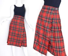 Great quality 1980s vintage women's kilt skirt in Royal Stewart tartan plaid, which is predominantly red with green, blue, black, yellow, and white. Features a high waistline, traditional kilt style w