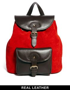 this red and brown leather back pack is so perfect !! Want want want the next time we shop!