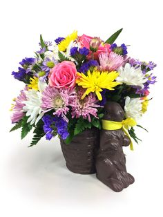 """CHOCOLATE BUNNY CENTERPIECE This beautiful spring array designed in a """"chocolate bunny"""" will accent your Easter celebration beautifully! Looks good enough to eat too!"""