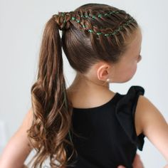 4 strand ribbon braids wrapped around a curly ponytail. (Sparkles on the top of her head too...although you can barely see them)